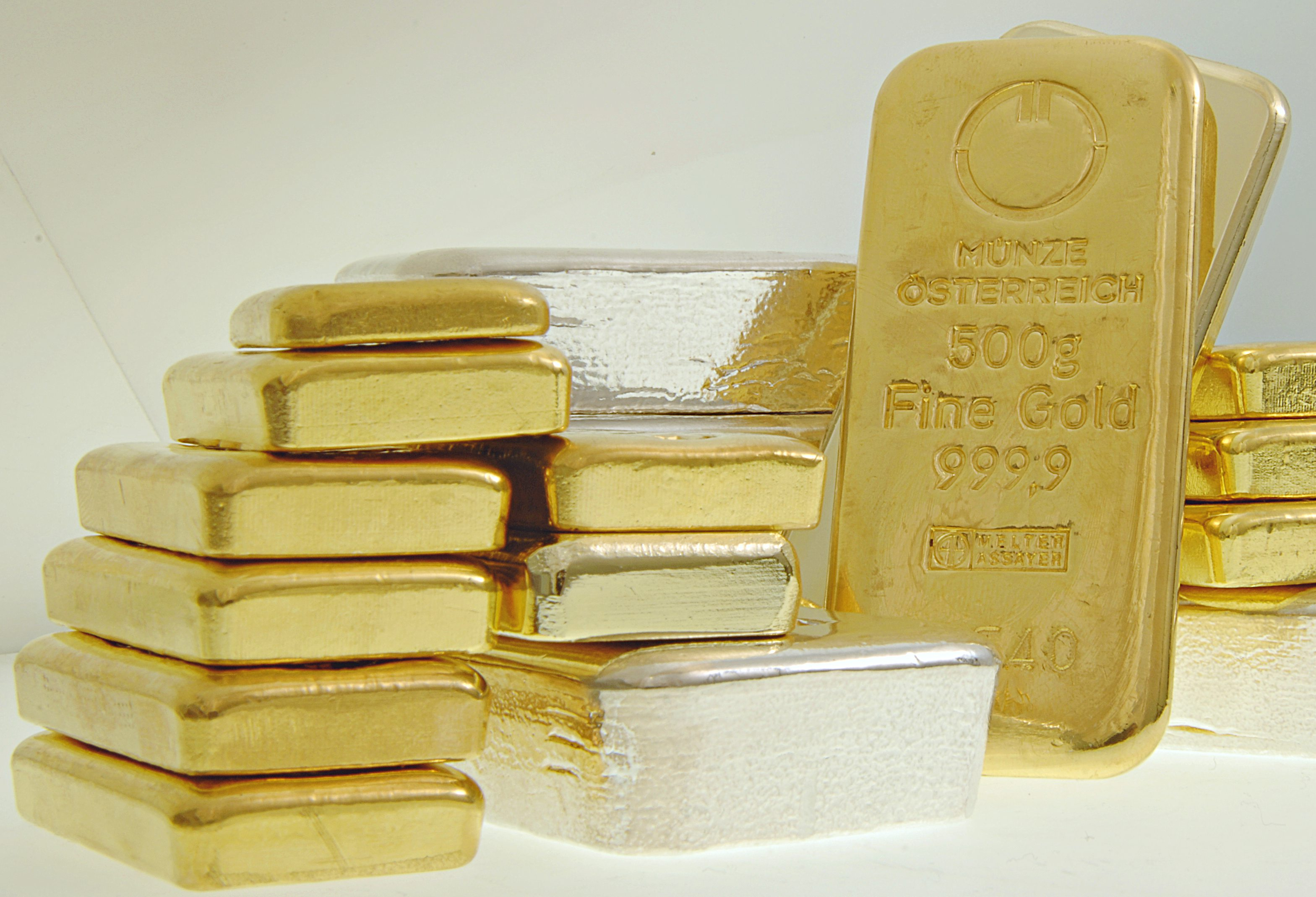 gold silver bars stacked